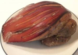 Pastured pork roast with scoring on the good fat cap.