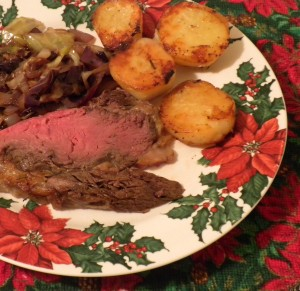 Grass fed meat, roast potatoes, and cabbage for a Christmas holiday feast.