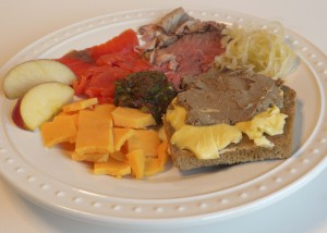 My Real Food Plate with grass fed prime rib, traditional sauerkraut, sourdough spelt bread with pastured butter and grassfed bison liver pate, raw cheese, smoked wild salmon, and fermented raw vegetable salsa.
